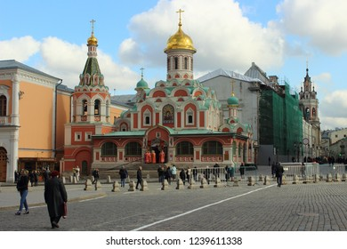 Russia / Moscow - 04 12 2017: Kazan Cathedral and clergy on the red square of the Moscow Kremlin on spring day-religion, Christianity, faith against the blue sky with clouds
