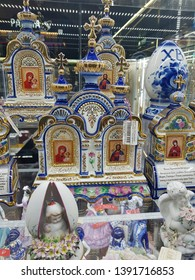 Russia, Moscow 04/05/2019 Traditional Russian porcelain souvenirs Gzhel with religious themes