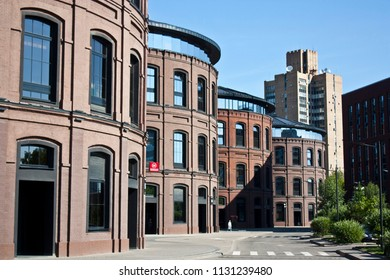 "Russia, Moscow. 06.08.2018. Four red brick round 3 floor building. Ex-gasholder.Business-quarter ""Arma""."