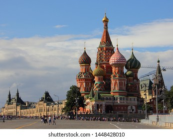 Russia / Moscow - 07 02 2019: St. Basil's Cathedral on the background of the Central store GUM on red square on a summer day against the blue cloudy sky, the sights of Moscow