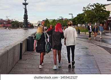 Russia / Moscow - 07 02 2019: Young emo people with colored hair walking in the Park Muzeon summer day - youth subculture, fashion Hobbies of youth