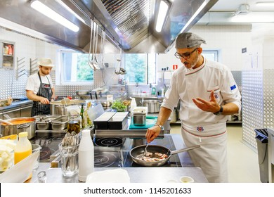 Russia, Moscow, 07.05.2018: our chef is cooking in the kitchen