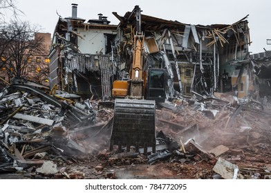 RUSSIA. MOSCOW. 09 February 2016: Demolition of illegal buildings in Moscow. Construction equipment breaks build near the metro Krasnopresnenskaya.