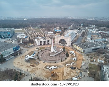 Russia, Moscow - 12 april 2019. VDNH. Repair of territory near rocket Vostok against of Cosmos pavilion - center for Cosmonautics and Aviation.