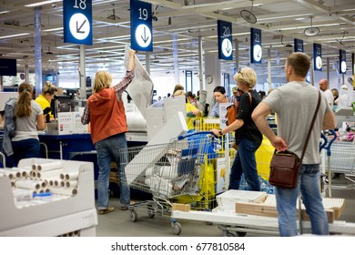 Russia, Moscow - 14 July 2017: At the checkout line in IKEA store. IKEA was founded in of Sweden in 1943, IKEA to have large chain stores around the world.