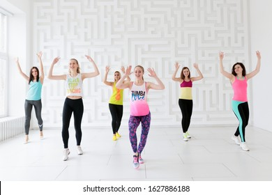RUSSIA, MOSCOW, 2017 - MARCH 12: Young women in sportswear at Zumba dance fitness class