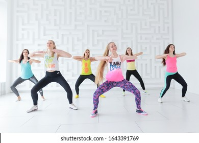RUSSIA, MOSCOW, 2017 - MARCH 12: Group of happy young women doing Zumba at Zumba dance class in white fitness studio