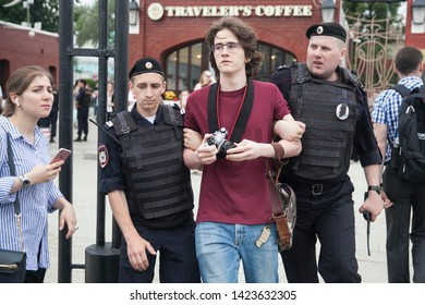 RUSSIA, MOSCOW - 2019/06/12: Law enforcement officers detain participant during rally. Protest held in Moscow over arrest of investigative journalist Ivan Golunov