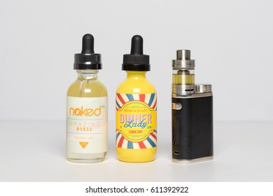 RUSSIA, MOSCOW - 29 MARCH 2017: Vape mod iStick Pico with the bottles of Premium e-juice liquids Naked and Dinner Lady.