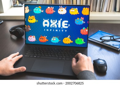 Russia Moscow 30.05.2021.Logo, screenshot of blockchain nft ethereum cryptocurrency game Axie in laptop screen. Man playing, collecting, creating crypto pets, heroes. Earning digital money tokens AXS.