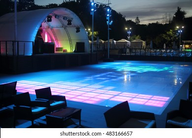RUSSIA, MOSCOW - 31 JUL, 2015: Colorful dancefloor with a stage and arc at VDNKH.