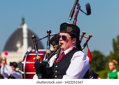 Russia, Moscow, All-Russian Exhibition Center, August 25, 2018 - International Celtic orchestra of bagpipes and drums at the Spasskaya Tower festival in Moscow. The musician plays the bagpipes, agains