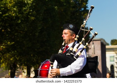 Russia, Moscow, All-Russian Exhibition Center, August 25, 2018 - International Celtic orchestra of bagpipes and drums at the Spasskaya Tower festival in Moscow. The musician plays the bagpipes