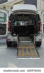 """RUSSIA, MOSCOW - APRIL 21, 2017: IX INTERNATIONAL CONFERENCE """"EQUAL RIGHTS - EQUAL OPPORTUNITIES"""". Ramp for the disabled in a car with open rear doors. Assistance in the transportation of sick people."""