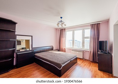 Russia, Moscow- April 24, 2020: interior room apartment modern bright cozy atmosphere. general cleaning, home decoration, preparation of house for sale. bedroom with bed