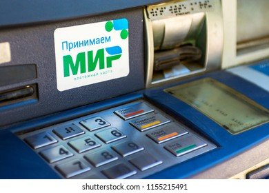 "Russia, Moscow - AUG 11, 2018: Logo of the Russian national payment system ""MIR"" on the ATM. The Russian national payment system ""MIR"" was established in late 2015."