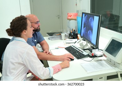 RUSSIA, MOSCOW - AUG 31, 2015: two doctors shows magnetic resonance exam procedure, view from control room in multidisciplinary Clinic Center Endosurgery and Lithotripsy (CELT)