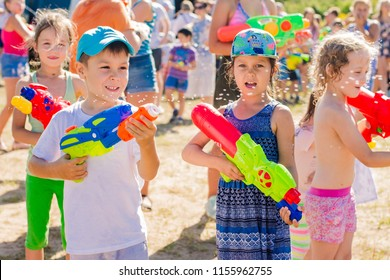 Russia. Moscow. August 11, 2018 Children playing outdoors with water cannons on a beautiful sunny day. Water battle, water game battle