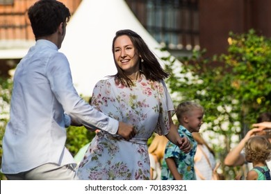 Russia, Moscow, August 20, 2017 - jazz festival in the Hermitage Garden, young man and woman dancing swing