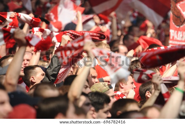 Russia, Moscow, August 2015 : Fans of Spartak Moscow cheer on their team during a friendly game against FC Dynamo