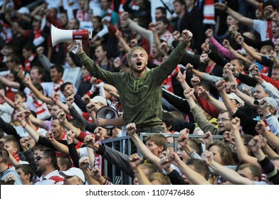 RUSSIA, MOSCOW, AUGUST 2017: Fans of the football club Spartak (Moscow) support their team during a match against the team of Lokomotiv (Moscow)