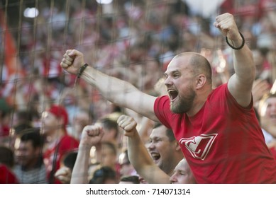 RUSSIA, MOSCOW, AUGUST 2017: Fans of Spartak's football club (Moscow) are delighted with a goal scored in the gate of the futolist club Lokomotiv (Moscow)