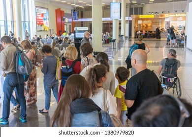 Russia, Moscow, August 2018: Closeup Queue of Europen people waiting at boarding gate at airport