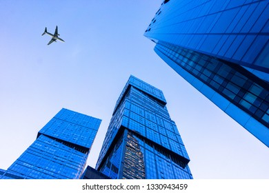 Russia, Moscow, August 2018: The plane flies over the skyscrapers in the Moscow-City area in Moscow.