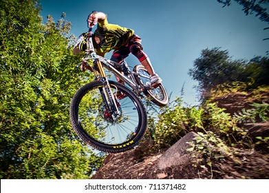 Russia, Moscow - August 31, 2017: Jump and fly on a mountain bike. Cyclist in action at mountain bike sport. Biker riding in nature. Cool athlete cyclist on a bike. MTB biking.