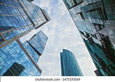 Russia Moscow City 08/07/2019.View of the top of modern glass skyscrapers against the blue sky. Architectural business background