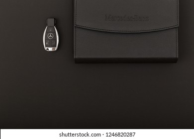 RUSSIA, MOSCOW - December 02, 2018: Mercedes Benz key with a black leather wallet