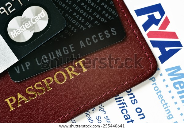 RUSSIA, MOSCOW - FEB 22, 2015: Premium credit card MasterCÂ¡ard Black Edition, Priority Pass card for VIP lounge access and international passport on the RYA (Royal Yacht association) certificate.