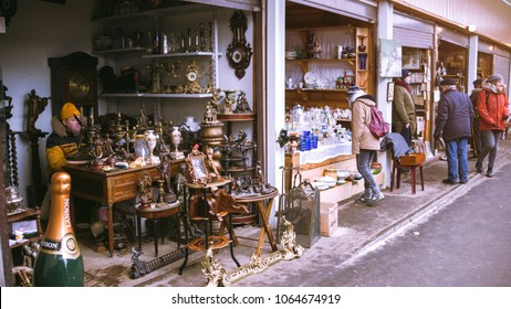 RUSSIA, MOSCOW - FEBRUARY 06, 2018: Tourists and buyers choose antique souvenirs in Flea market  of Izmailovsky Kremlin.