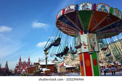Russia, Moscow - February 14, 2018: Girls ride on carousel on Red Square during russian winter holidays