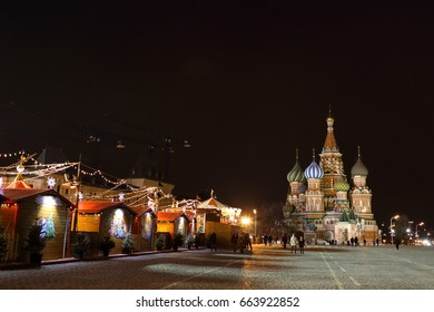 RUSSIA, MOSCOW, FEBRUARY 18, 2015, THE KREMLIN. Night photo of Red Square with a view of the Cathedral of Basil the Blessed. On the square there are tents from the winter holidays.