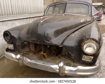 Russia, Moscow, February 22, 2014 - Damaged Soviet car GAZ-12 ZIM