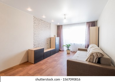 Russia, Moscow- July 06, 2019: interior room apartment. standard repair decoration in hostel. living room with sofa