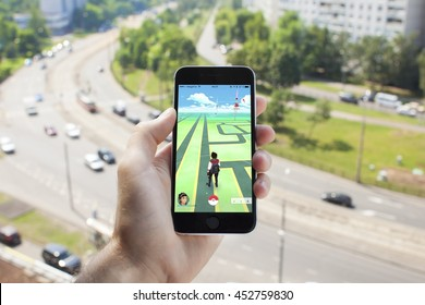 Russia, Moscow - July 15, 2016 : Apple iPhone 6 held in one hand showing its screen with Pokemon Go application.