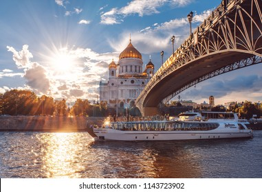 Russia, Moscow - July 5 2018: Ship of Flotilla Radisson Royal. Moscow River Cruise.  The Cathedral of Christ the Savior at sunset.