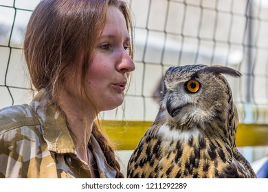 "RUSSIA, MOSCOW - JUNE 02, 2018: First Festival ""Petshop Day"". Video blogger Nika Zubra with her owl Yol'."