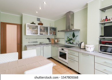 Russia, Moscow- June 11, 2019: interior room apartment. standard repair decoration in hostel. kitchen and dining room