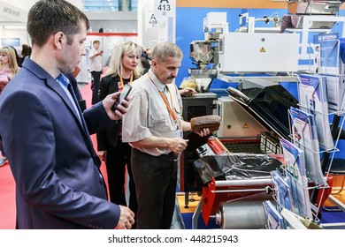 """RUSSIA, MOSCOW - June 14, 2016: Visitors and exhibitors visiting the stands and exhibits at the exhibition """"RosUpack"""" at Crocus Expo. Exhibition held in Moscow. International Exhibition"""