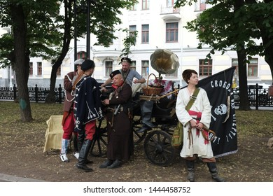 "RUSSIA, MOSCOW – JUNE 15 2019: ""Times and epochs"" festival.  Reenactors in characters of Russian anarchists (anarchists of bat'ko Makhno). Historical reconstruction. Russian civil war. 20th century."