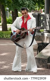 Russia, Moscow June 16, 2012, Hermitage Garden, Food Festival - man with a guitar in the costume of Elvis Presley