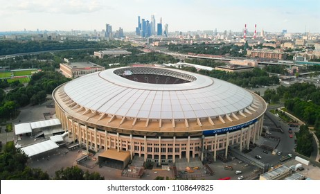 RUSSIA MOSCOW JUNE 2018: Aerial shot of FIFA 2018 Stadium Luzhniki. Cloudy sky and Moscow-city towers on the hazy horizon.