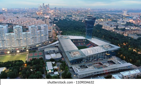 RUSSIA MOSCOW JUNE 2018: Beautiful shot of VEB Arena stadium. Bright city lights in the evening. Multistory houses and parks around the stadium.