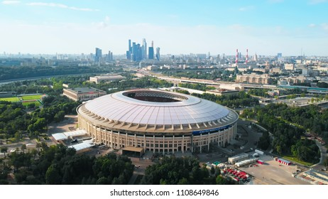 RUSSIA MOSCOW JUNE 2018: Flying around the stadium Luzhniki. Moscow-city towers on the horizon. Beautiful day with bright blue and a little hazy sky.