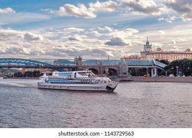 Russia, Moscow - June 7, 2018:  The Ship of the Flotilla Radisson and Pushkin (Andreevsky) Bridge in Gorky Park.
