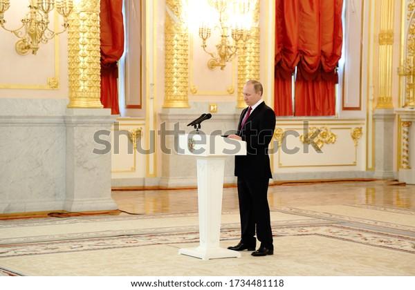 Russia. Moscow. Kremlin. 05.13.2017. Presentation of credentials to the ambassadors. Vladimir Putin stands near the podium