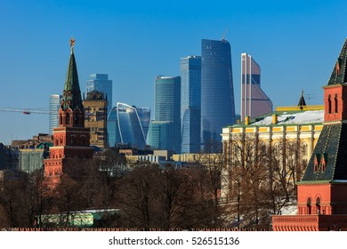 """Russia, Moscow, Kremlin tower on the background of high-rise buildings of the complex """"Moscow City"""""""